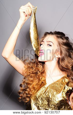 Attractive Young Girl With Golden Fish