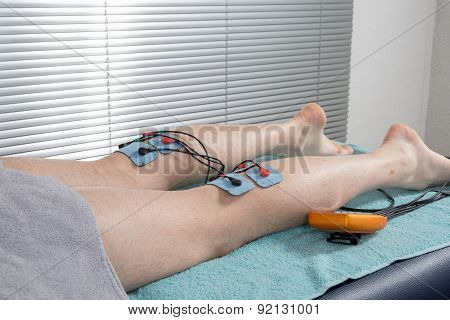 Electrodes on man's legs