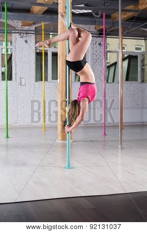 Pole Dancer Doing Advanced Figure