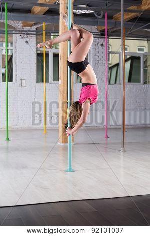 Pole Dancer Doing Advanced Figure