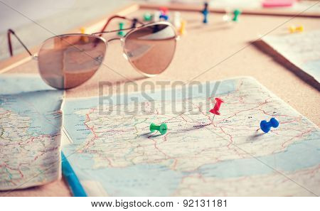 Travel destination points on a map and sunglasses