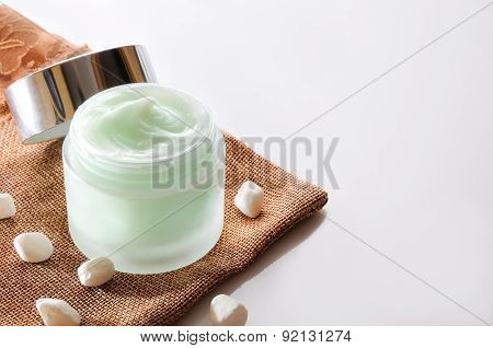 Cream Jar Open On Burlap Top View Isolated