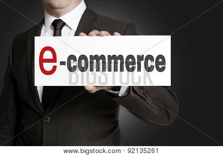 Ecommerce Sign Held By Businessman