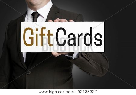 Gift Cards Sign Is Held By Businessman