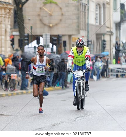 A Single Male Runner And A Bicycling Man