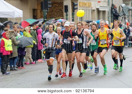 A Large Group Of Male Runner