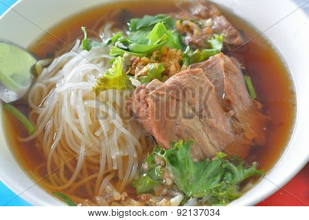 Rice Noodle In Chinese Traditional Medicine Soup With Stew Pork Ribs.