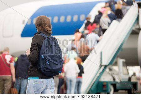 Girl Boarding Plane, Back View