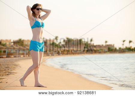 Young Woman In Sunglasses And Swimwear