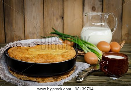 Pie With Onions And Eggs On The Wooden Table