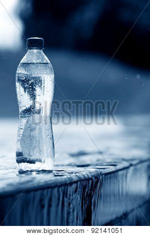 PET bottle with water on a water surface background