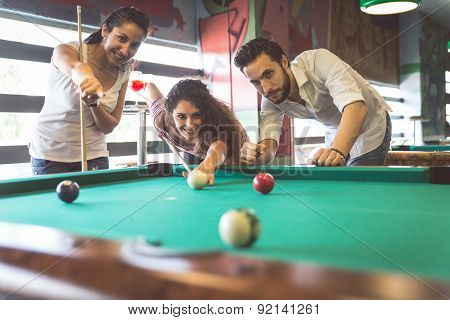 Group Of Friends Playing Pool