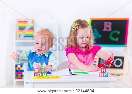 Kids At Preschool Painting