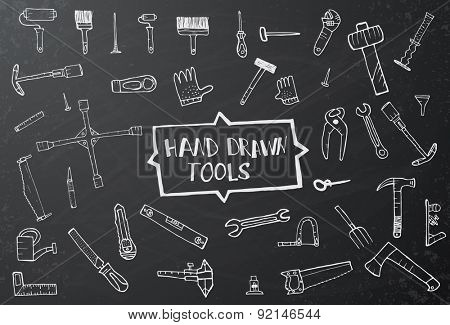 Hand drawn tool icons set on black chalk board