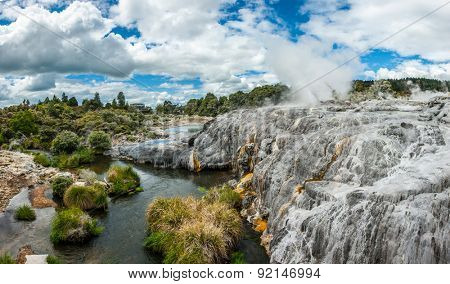 White travertine terraces and Pohutu with Prince of Wales geysers in Rotorua area, New Zealand. Panoramic photo