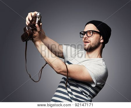 I Love Selfie! Handsome Young Man In Shirt Holding Camera And Making Selfie And Smiling
