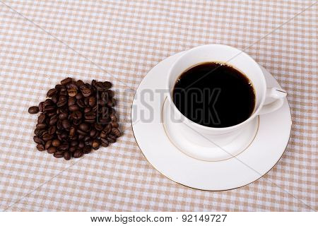 Black coffee cup with coffee beans