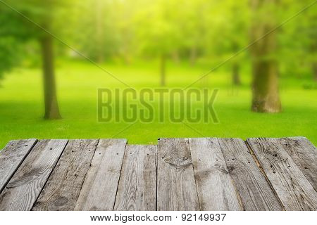 View From Wooden Table To The Green Bokeh Background