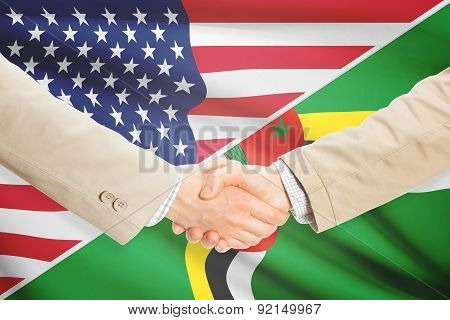 Businessmen Handshake - United States And Dominica