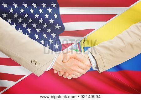 Businessmen Handshake - United States And Ecuador