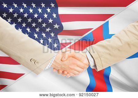 Businessmen Handshake - United States And Faroe Islands