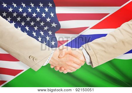 Businessmen Handshake - United States And Gambia