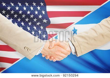 Businessmen Handshake - United States And Honduras