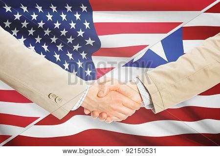 Businessmen Handshake - United States And Liberia
