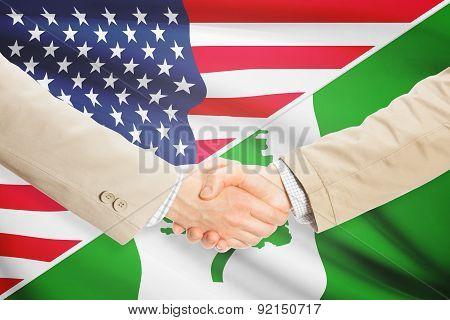 Businessmen Handshake - United States And Norfolk Island