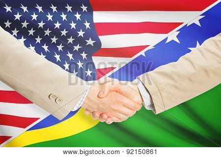 Businessmen Handshake - United States And Solomon Islands
