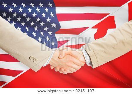 Businessmen Handshake - United States And Tonga