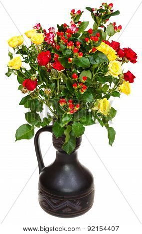 Yellow, Red Roses And Hypericum Flowers In Jug
