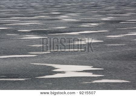 Snow Drifts On Frozen Lake