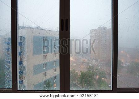 Raindrops On Urban House Wndow During Rain