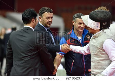 ST. PETERSBURG, RUSSIA - MAY 3, 2015: Italian team handshakes with judges after team semifinal of International fencing tournament St. Petersburg Foil. The tournament is the stage of FIE World Cup