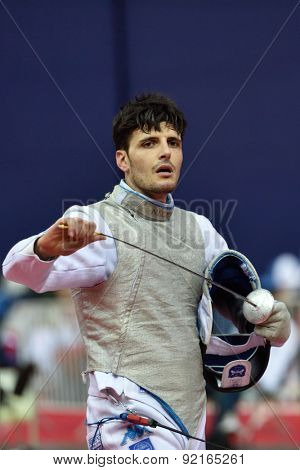 ST. PETERSBURG, RUSSIA - MAY 3, 2015: Andrea Cassara of Italy in team semifinal of 41th International fencing tournament St. Petersburg Foil. The tournament is the stage of FIE World Cup