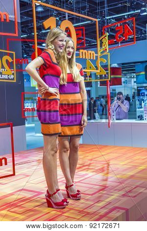 models pose for visitors at Photokina in Cologne Germany