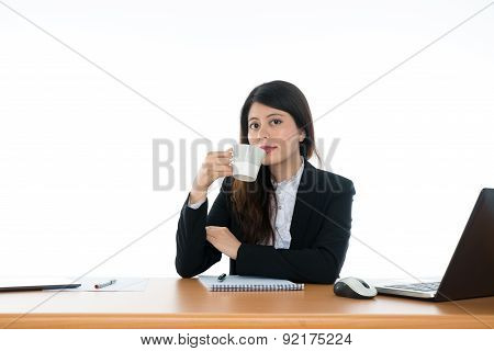 Businesswoman Sitting At Office Desk