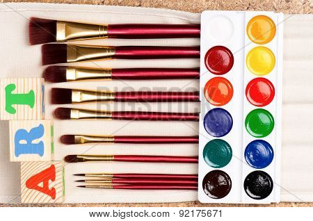 Close up of paints and brushes, top view