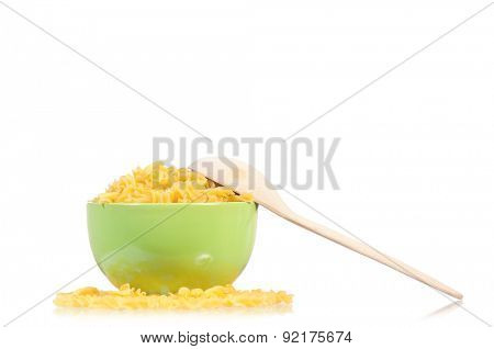 Raw pasta in bowl isolated on white background