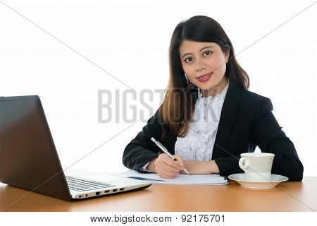 Happy Businesswoman Sitting At Office Desk