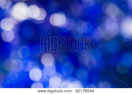 Blurred Light  Bokeh On Blue Background