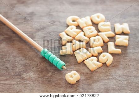 Alphabet Biscuit On Wooden Table