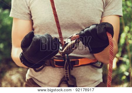 Guamka, Russia, 03 May 2015: Man Ensures The Safety Of Climber Man With Ropes And Device Grigri, 03