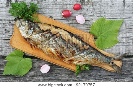 Grilled Herring, Radishes And Parsley On A Cutting Boards Close Up