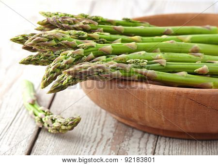 Asparagus in a wooden plate