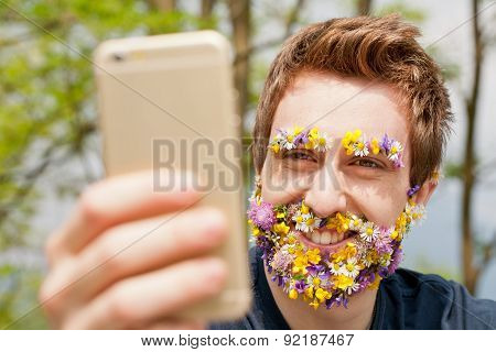 Hipster Man Covered With Flowers Texting