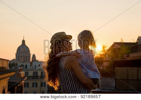 Mother In Profile Holding Daughter In Her Arms Overlooking Rome