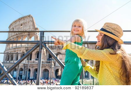 Mother And Daughter Tourists At The Colosseum In Rome