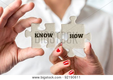 Hands Holding Puzzle Pieces For Know How Concept